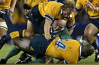 Rugby World Cup. Australia v Ireland at Telstra Dome, Melbourne. Irish captain Keith Wood sandwiched between Phil Waugh and Wendell sailor.