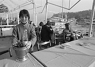 Young boy works a s a waiter in Istanbul, Turkey - Child labor as seen around the world between 1979 and 1980 – Photographer Jean Pierre Laffont, touched by the suffering of child workers, chronicled their plight in 12 countries over the course of one year.  Laffont was awarded The World Press Award and Madeline Ross Award among many others for his work.