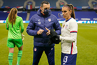 LE HAVRE, FRANCE - APRIL 13: Vlatko Andonovski head coach of the United States has a few words with his pupil Alex Morgan #13 during a game between France and USWNT at Stade Oceane on April 13, 2021 in Le Havre, France.