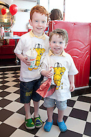 """NO REPRO FEE. 26/5/2011. NEW EDDIE ROCKET'S SHAKE SHOP. Eli 5 and Zane 3 Green are pictured in the new Eddie Rocket's Shake Shop. The design seeks to recall the vintage milkshake bars from 1950's America and re-imagine them for the 21st century. The new look aims to appeal to both young and old with a quirky and bold colour scheme and a concept of make-your-own milkshakes, based on the tag line """"You make it...We shake it!"""". Eddie Rocket's City Diner in the Stillorgan Shopping Centre in south Dublin has re-opened after an exciting re-vamp and the addition of a Shake Shop. Ten new jobs have been created with the Diner's re-launch bringing the total working in Eddie Rocket's Stillorgan to 30. Picture James Horan/Collins Photos"""