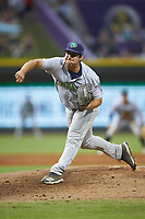 Lynchburg Hillcats relief pitcher Aaron Pinto (4) follows through on his delivery against the Winston-Salem Dash at BB&T Ballpark on August 1, 2019 in Winston-Salem, North Carolina. The Dash defeated the Hillcats 9-7. (Brian Westerholt/Four Seam Images)