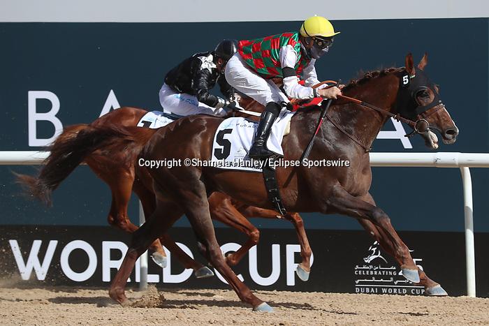 March 27, 2021: DERYAN #5 ridden by Iortiz Mendizabal wins The Group 1 Kahayla Classic for Didier Guillemin on Dubai World Cup Day, Meydan Racecourse, Dubai, UAE. Shamela Hanley/Eclipse Sportswire/CSM