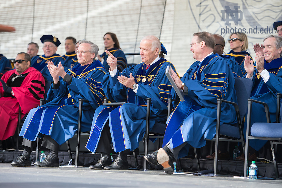 May 15, 2016; Vice President Joe Biden, reacts as he listens to John Boehner, former Speaker of the House, speak at the 2016 Commencement ceremony at Notre Dame Stadium. (Photo by Barbara Johnston/University of Notre Dame)