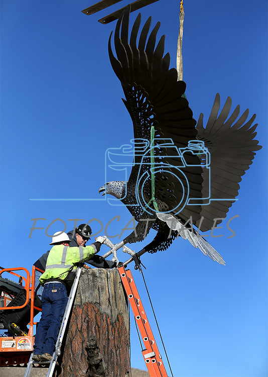 Crews install an 8' x 16', 800-pound metal eagle sculpture at Spooner Junction in south Carson City, Nev., on Thursday, Dec. 21, 2017.<br /> Photo by Cathleen Allison/Nevada Momentum