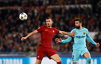 Roma s Edin Dzeko, left, is challenged by FC Barcelona Gerard Pique during the Uefa Champions League quarter final second leg football match between AS Roma and FC Barcelona at Rome's Olympic stadium, April 10, 2018.<br /> UPDATE IMAGES PRESS/Riccardo De Luca