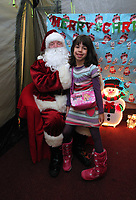 Pictured: Father Christmas meets young girl in his grotto. Thursday 15 December 2011<br />