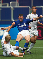 Joey DiGiamarino of the MetroStars blocks the shot Chris Klein of the Wizards as Craig Ziadie trails. The Kansas City Wizards and the NY/NJ MetroStars played to a 0-0 tie on 8/13/03 at Giant's Stadium, NJ..
