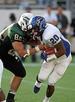 Armwood Hawks running back Wade Edwards #20 is hit by defensive lineman Jordan Hinojosa #88 in the backfield during the fourth quarter of the Florida High School Athletic Association 6A Championship Game at Florida's Citrus Bowl on December 17, 2011 in Orlando, Florida.  Armwood defeated Miami Central 40-31.  (Mike Janes/Four Seam Images)