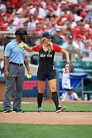 Fox Sports Charissa Thompson throws the ball back to the pitcher in front of umpire JJ January during the All-Star Legends and Celebrity Softball Game on July 12, 2015 at Great American Ball Park in Cincinnati, Ohio.  (Mike Janes/Four Seam Images)