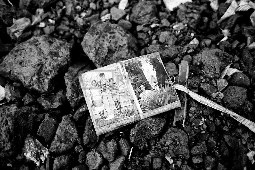 A Family Album found from inside of the collapsed building. Savar, near Dhaka, Bangladesh