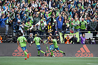 SEATTLE, WA - NOVEMBER 10: Raul Ruidiaz #9 of the Seattle Sounders FC celebrates scoring his goal with teammates Jordy Delem #21, Joevin Jones #33, and Victor Rodriguez #8 during a game between Toronto FC and Seattle Sounders FC at CenturyLink Field on November 10, 2019 in Seattle, Washington.