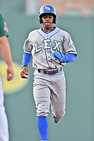 Lexington Legends right fielder Khalil Lee (9) runs back to first base during a game against the Greenville Drive at Fluor Field at West End on April 10, 2017 in Greenville, South Carolina. The Legends defeated the Drive 12-4 (Tony Farlow/Four Seam Images)
