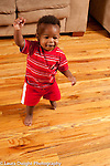 13 month old baby boy first stemps walking arm raised