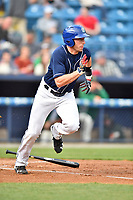Asheville Tourists designated hitter Vince Fernandez (8) runs to first base during a game against the Greensboro Grasshoppers at McCormick Field on April 27, 2017 in Asheville, North Carolina. The Tourists defeated the Grasshoppers 8-5. (Tony Farlow/Four Seam Images)