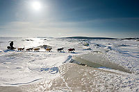 Gerry Wilomitzer runs through jumbled sea ice on the in-bound trail just shorlty before the village of Koyuk in Arctic Alaska during the 2010 Iditarod