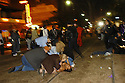 Revelers and police responded to a three people shot on the St. Charles parade route, 2004.