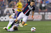 Foxborough, Massachusetts - September 3, 2016: First half action. In a Major League Soccer (MLS) match, New England Revolution (blue/white) vs Colorado Rapids (yellow/blue), at Gillette Stadium.<br /> Penalty kick foul and yellow card.