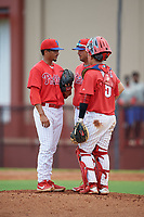 GCL Phillies West pitching coach Bruce Billings (center) talks with pitcher Aidan Anderson (46) and catcher Bruce Wang (5) during a Gulf Coast League game against the GCL Yankees East on August 3, 2019 at the Carpenter Complex in Clearwater, Florida.  The GCL Phillies West defeated the GCL Yankees East 15-7 in a completion of a game that was originally started on July 26, 2019.  (Mike Janes/Four Seam Images)