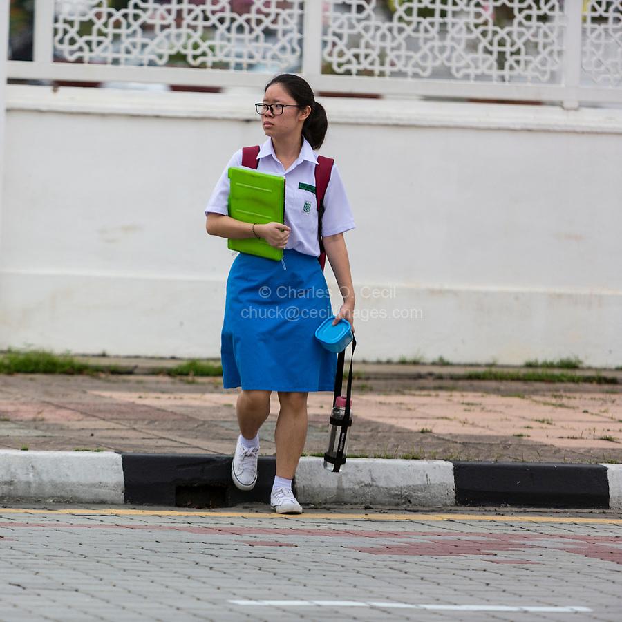 Young Malaysian Girl Student Preparing to Cross the Street, Ipoh, Malaysia.