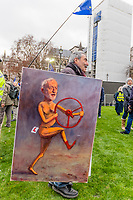LONDON, ENGLAND - JANUARY 15: Artist Kaya Mar holds two satirical paintings outside the House of Commons on January 15, 2019 in London, England. Theresa May's Brexit deal finally reaches the House of Commons this evening and MPs will begin voting on it at 7pm. The Prime Minister has consistently said her's is the only deal that Brussels will entertain and urged support from Parliament to avoid the UK crashing out of the European Union with no deal. Photo Adamo Di Loreto