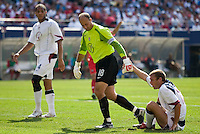 USA goalkeeper Kasey Keller helps teammate Jimmy Conrad to his feet. The United States defeated Panama 3-1 in a shoot out after a scoreless game to win the CONCACAF Gold Cup at Giant's Stadium, East Rutherford, NJ, on July 24, 2005.