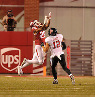 NWA Democrat-Gazette/MICHAEL WOODS • @NWAMICHAELW<br /> University of Arkansas defender Jared Collins goes up for an interception in fromt of Texas Tech receiver Ian Sadler in the 2nd quarter of Saturday nights game at Razorback Stadium in Fayetteville.