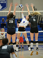 Rogers' Brooke Park (8) sends the ball over the net Tuesday, Oct. 13, 2020, as Bentonville's Allison Oliphant (28) and Gloria Cranney (6) defend during play in King Arena in Rogers. Visit nwaonline.com/201014Daily/ for today's photo gallery. <br /> (NWA Democrat-Gazette/Andy Shupe)