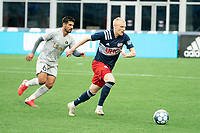 FOXBOROUGH, MA - APRIL 17: Connor Presley #7 of New England Revolution II breaks with the ball in the midfield during a game between Richmond Kickers and Revolution II at Gillette Stadium on April 17, 2021 in Foxborough, Massachusetts.