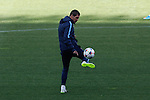 Atletico's coach Diego Simeone controls the ball during a training session the day before quarterfinal first leg Champions League soccer match against Real Madrid at Vicente Calderon stadium in Madrid, Spain. April 13, 2015. (ALTERPHOTOS/Victor Blanco)