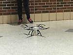The team from Northside High School demonstrated how their large drone could deliver messages by delivering one to their principal.