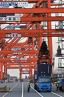 Workers at the Port of Tokyo, Japan. Industrial production in Japan plunged at the steepest pace in 55 years in the fourth quarter, and unemployment rose at the fastest rate in 41 years with exports in the third quarter were a record 13.9 per cent lower than in the previous quarter..19 Feb 2009