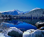 A winter scenic of Bear Lake with Longs Peak in the distance in Rocky Mountain National Park, Colorado.