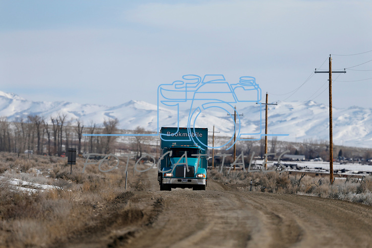 The Elko County Bookmobile arrives at the one-room schoolhouse in Ruby Valley, near Elko, Nev., on Monday, March 18, 2019. Three Bookmobiles cover more than 52,000 square miles throughout rural Nevada bringing books, laptops, Wi-Fi, classes and programming to their users.  <br /> Photo by Cathleen Allison/Nevada Momentum