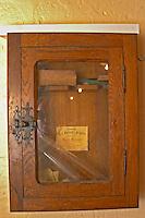 Cupboard with old tools, pipette and label - Chateau La Grave Figeac, Saint Emilion, Bordeaux