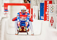 4 December 2015: Alexander Denisyev and Vladislav Antonov, sliding for Russia, cross the finish line after their second run, finishing 13th for the day with a combined time of 1:28.991 in the Doubles Competition of the Viessmann Luge World Cup at the Olympic Sports Track in Lake Placid, New York, USA. Mandatory Credit: Ed Wolfstein Photo *** RAW (NEF) Image File Available ***