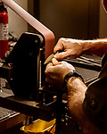 April 16, 2019. Southern Pines, North Carolina.<br /> <br /> Lannie Harper hand sharpens a knife at Spartan Blades.  <br /> <br /> Spartan Blades and Southern Pines Brewing Company are owned by veterans of the United States military Special Operations community.
