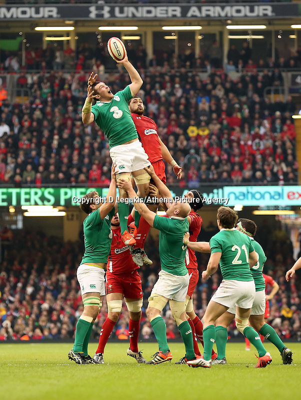 Pictured: An Ireland player almost loses the ball from a line out to Taulupe Faletau of Wales Saturday 14 March 2015<br /> Re: RBS Six Nations, Wales v Ireland at the Millennium Stadium, Cardiff, south Wales, UK.