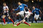 Kenny Miller skips past the challenge of Falkirk's Joe Shaughnessey