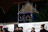 Fans stand in a their own temporary stand made out of scaffolding as they watch the game over the fence during the Fly Emirates FA Cup Fourth Round match between Newport County and Tottenham Hotspur at Rodney Parade, Newport, Wales, UK. Saturday 27 January 2018