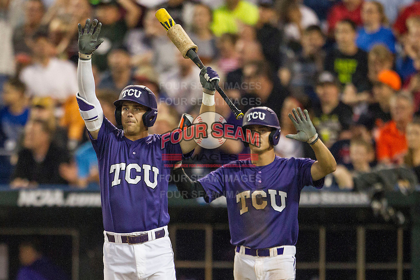 TCU Horned Frogs third baseman Derek Odell (5) and Keaton Jones (26) signal to an oncoming baserunner against the LSU Tigers in Game 10 of the NCAA College World Series on June 18, 2015 at TD Ameritrade Park in Omaha, Nebraska. TCU defeated the Tigers 8-4, eliminating LSU from the tournament. (Andrew Woolley/Four Seam Images)