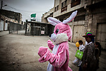 A woman dressed as a habit walks past a checkpoint , as Jewish settlers celebrate the Purim holiday in a parade at the West Bank city of Hebron Sunday March 12 2017. Purim is a Jewish holiday that commemorates the saving of the Jewish people in ancient Persia , the story is recorded in the Biblical Book of Esther. Photo by Eyal Warshavsky