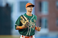 Greensboro Grasshoppers center fielder Connor Scott (23) jogs off the field between innings of the game against the West Virginia Power at First National Bank Field on August 9, 2018 in Greensboro, North Carolina. The Power defeated the Grasshoppers 9-7 in game two of a double-header. (Brian Westerholt/Four Seam Images)