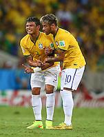 Neymar of Brazil helps an injured Thiago Silva to his feet
