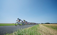peloton stretching and breaking into echelons thanks to offensive riding by Team OmegaPharma-Quickstep (here led by Niki Terpstra (NLD)<br /> 2nd echelon just broke off as seen in the distance<br /> <br /> Tour de France 2013<br /> stage 13: Tours to Saint-Amand-Montrond, 173km