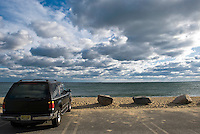Car parked at a deserted Cape Cod beach during the off season.