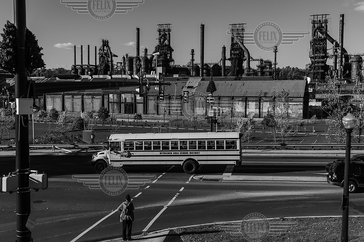 A school bus passes the former Bethlehem Steel plant which closed at the end of 1995. Today, the old mill is part of a city park dedicated to art, culture and community events, and is one of the main tourist attractions in the region.