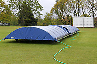 The covers are on the pitch after heavy rain fell ahead of Wanstead and Snaresbrook CC vs Hornchurch CC, Hamro Foundation Essex League Cricket at Overton Drive on 8th May 2021