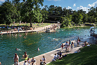 Jumping off the diving board is a favorite pastime at Barton Springs Pool in Zilker Park in downtown Austin, Texas.