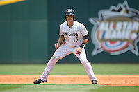 Trayce Thompson (15) of the Charlotte Knights takes his lead off of first base against the Norfolk Tides at BB&T BallPark on June 7, 2015 in Charlotte, North Carolina.  The Tides defeated the Knights 4-1.  (Brian Westerholt/Four Seam Images)