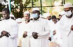 Sudanese Muslim worshipers, some wearing masks perform the Eid al-Fitr prayer despite concerns over the COVID-19 coronavirus outbreak in the capital Khartoum, Sudan on May 24, 2020. Photo by faiz Abu bakr